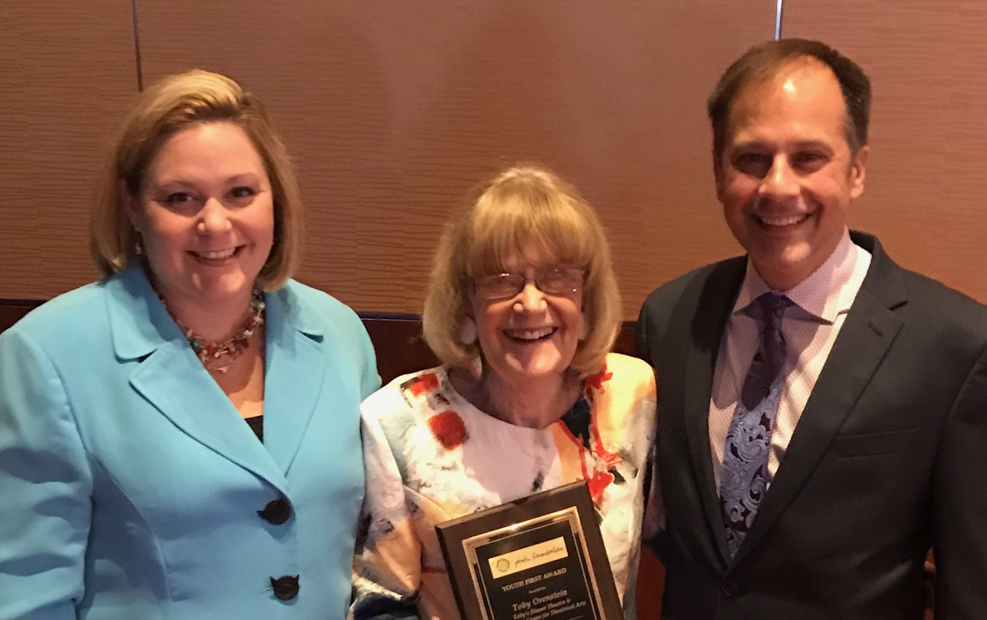 Toby Orenstein with Cheryl Clemens-Everidge and Mark Minnick receiving her Youth First Award from the SYTA Foundation 2018